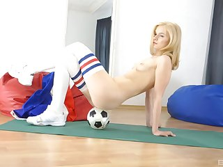 Tow-headed soccer indulge Kyra Yorke poses provocatively in a miniskirt