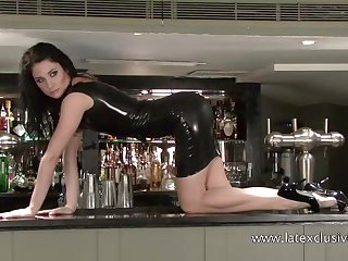 Unwitting solo wide of too belt hard latex bitch posing on the bar counter